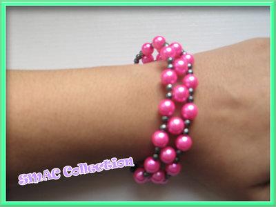 Bracciale intrecciato con perle e perline