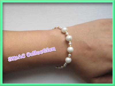 Bracciale rigido con perle e perline