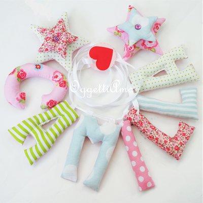 Una romantica ghirlanda come idea regalo originale per la nascita o il compleanno di Camilla: una ghirlanda per decorare la cameretta con il suo nome!