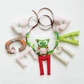 Un'idea regalo originale per Gemma: una ghirlanda di lettere di stoffa per decorare la sua cameretta con il suo nome ed una civetta