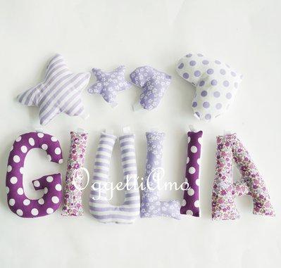 Giulia: una ghirlanda di lettere di stoffa imbottite per decorare la sua cameretta con il suo nome in lilla e viola