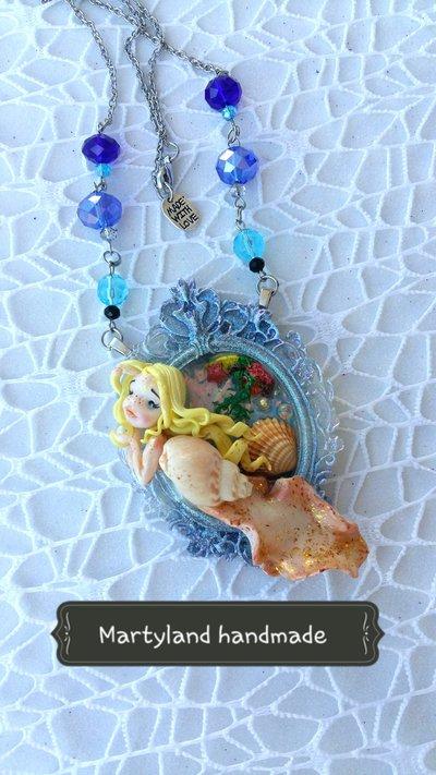 Lumachina marina con conchiglia
