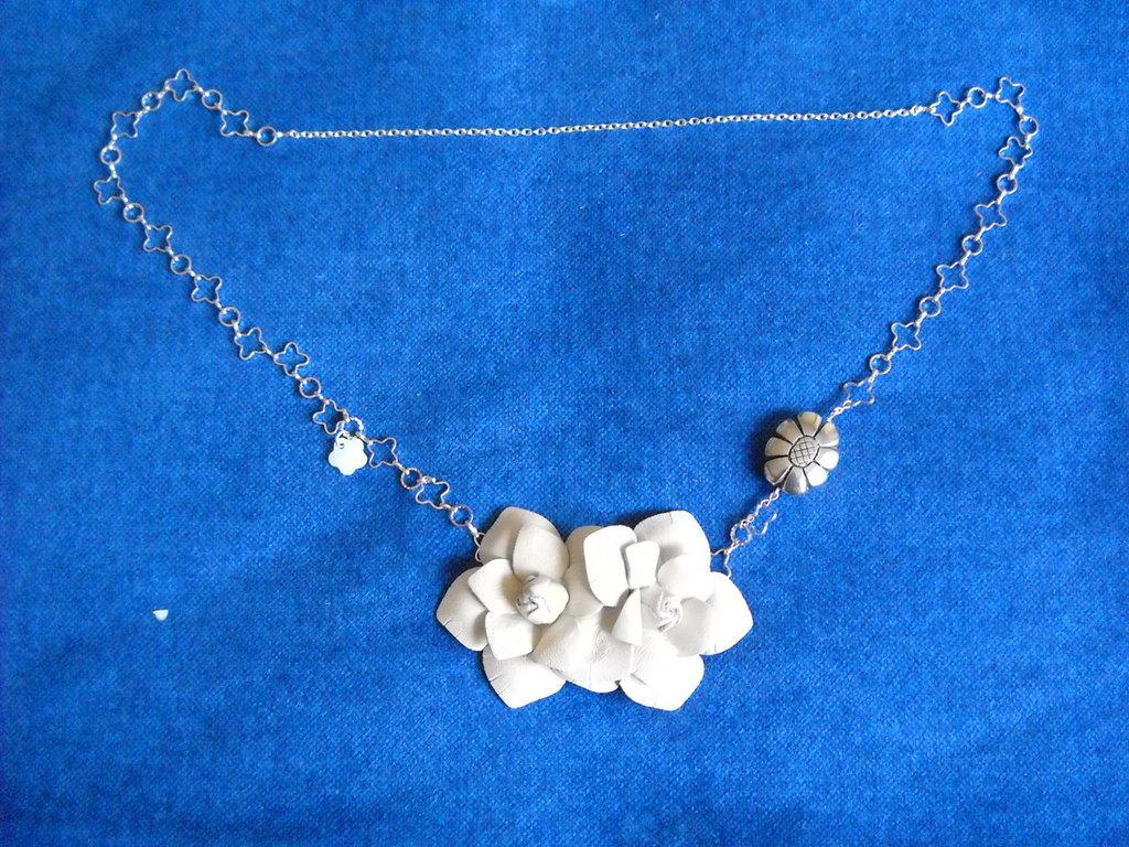Collana handmade in metallo e pelle