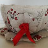 Tazza rossa in stoffa imbottita con coccinelle rosse