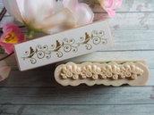Timbro in legno e gomma con bordo