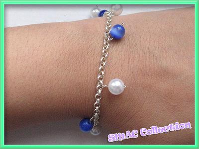 Bracciale con ciondoli bianco blu