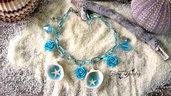 Bracciale mare conchiglie stelle marine alluminio azzurro rose regolabile gioielli artistici artigianale bigiotteria
