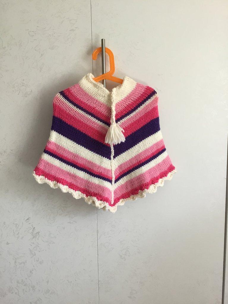 Poncho bimba di lana ai ferri