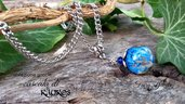collana sfera acciaio fatta a mano resina arte bigiotteria gioielli artigianali