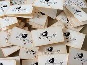 Bigliettini matrimonio avorio con uccellino sul ramo sul fronte e scritta interna
