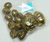 25 gr di argenti tibetani color oro di medie e agrandi dimensioni, mix