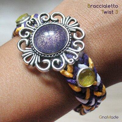 BRACCIALETTO TWIST 3 - con cordini intrecciati bianco giallo viola + cabochon glitter viola e oro