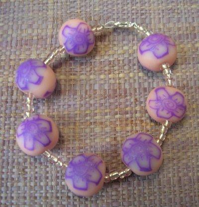 Bracciale con perle in pasta polimerica rosa decorate a murrina