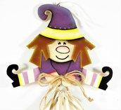 strega con sacchetto, strega in legno color viola , befana con sacchetto , halloween , epifania
