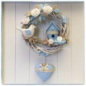 Fiocco nascita in vimini con uccellino , nido e cuore azzurro appeso