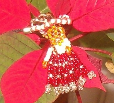 Bambola indiana con perline