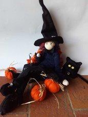 Halloween strega, gatto e zucche