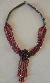 collana multifili con mezzo cristallo rosso ,ematite e ciondolo