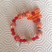 Braccialetto elastico con perle arancioni fatto a mano