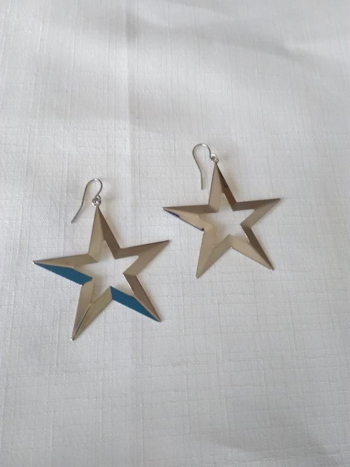 orecchini pendenti con stelle di natale