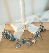 Braccialetto ciondoli azzurri tema mare. Conchiglie,polpo,stella,delfino. Idea regalo donna