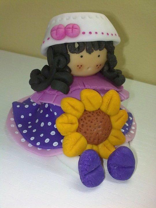 Bambola con girasole