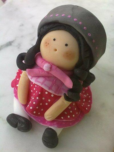 Bambolina rosa e grigia