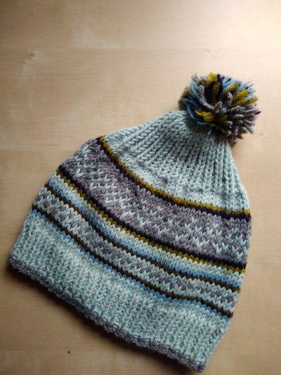Berretto ai ferri bambino disegni norvegesi con ponpon lana merino