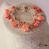 Bracciale in pietre dure. Agata striata, ciondoli stella marina fiore arancio arancione