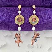 Orecchini in argento con immagini vintage di angeli