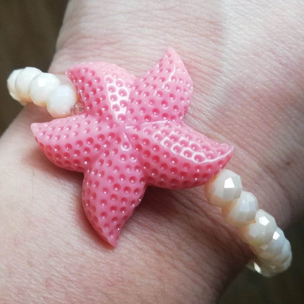 Bracciale stella marina e mezzi cristalli bianchi con sfumature rosa