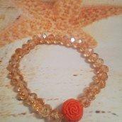 Bracciale elastico con cristalli champagne e perla con rosa