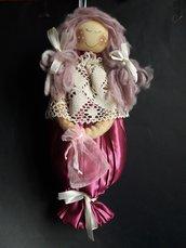 Bambola in fucsia
