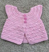 Bolero per bimba in cotone rosa confetto lavorato all'uncinetto