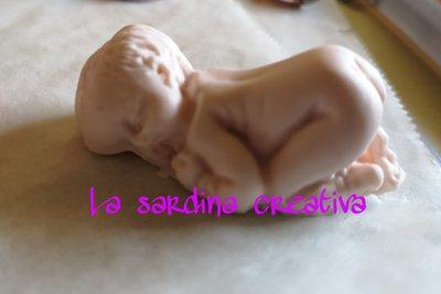 Neonato in miniatura