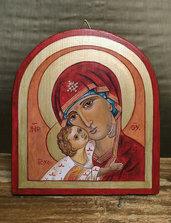 Icona dipinta interamente a mano con colori acrilici su tavola di legno massello.