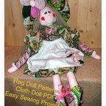 Cartamodello bambola di pezza colorata, con volto dipinto.