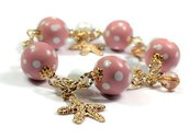 Braccialetto con perle rosa a pois