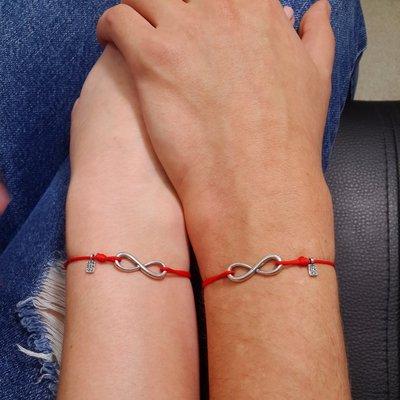 Coppia di bracciali di corda con pendente charm in argento Infinito, fatto a mano