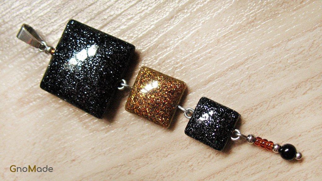 CIONDOLO 4LEVELS 5 - bronzo con glitter oro e nero + nero con glitter argento + charm -  atossico e nichel free