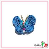 Farfalla blu e turchese all'uncinetto