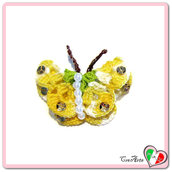 Farfalla giallo sfumato e verde all'uncinetto