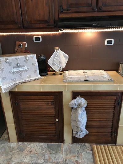 Vendo copri forno, copri fornelli, porta buste e presine