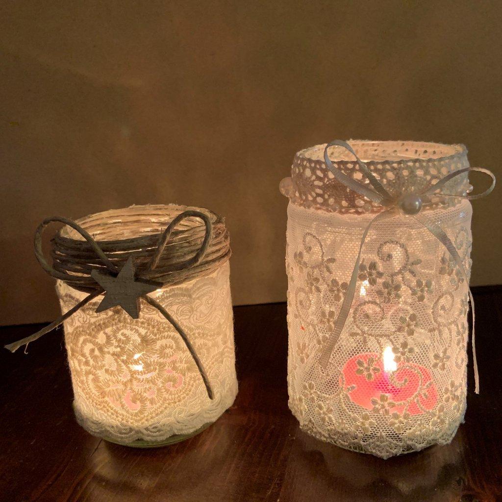 Portacandele con barattoli di vetro