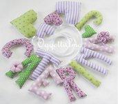 Una ghirlanda lilla e verde per decorare la cameretta di Caterina con il suo nome, cuori e fiorellini imbottiti