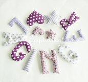 Una ghirlanda di lettere di stoffa per decorare la sua cameretta con il soprannome che le è stato dato per 9 mesi: un'idea regalo originale per accogliere la piccola in famiglia con un dolce ricordo