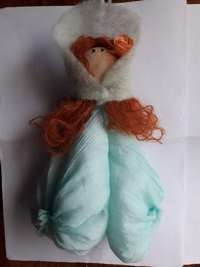 Bambola Evelyne verde