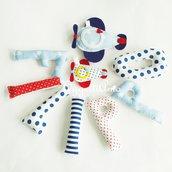 Filippo: una ghirlanda di lettere di stoffa rosse, celesti e blu con aeroplanini per decorare la sua cameretta con il suo nome