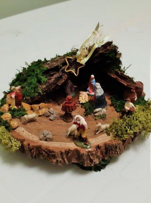 Natività su tronco