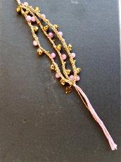 Bracciale a tre fili con pietre rosa